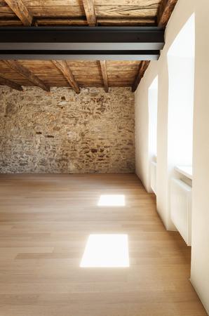 beautiful modern loft, room with stone wall