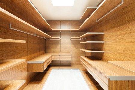 wide wooden dressing room, interior of a modern house 스톡 콘텐츠