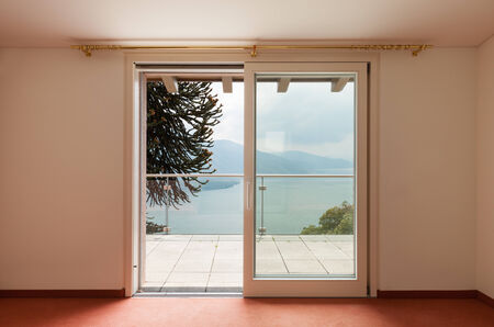wide open spaces: Interior, house, empty room with window