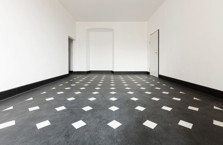 old empty apartment with black marble floors photo
