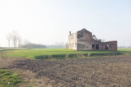 Typical Italian countryside of the po delta with fog photo