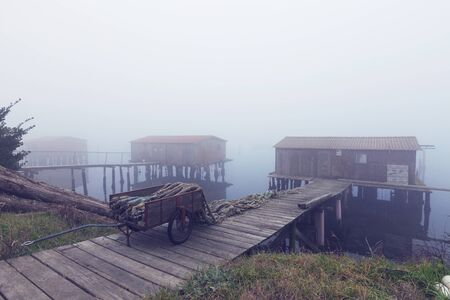 old pier: Typical Italian countryside of the po delta with fog