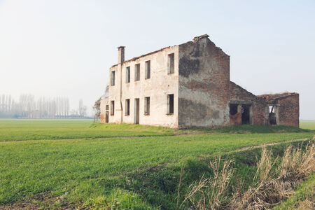 Abandoned farmhouse in the countryside photo