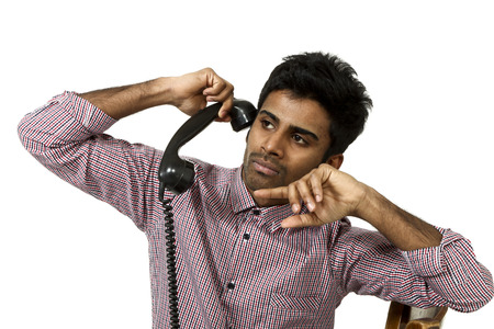 young man with a vintage telephone , portrait on white background