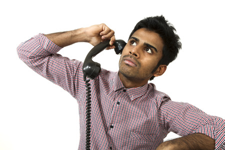 young man with a vintage telephone , portrait on white background photo