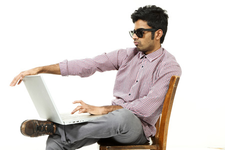portrait of young man with his laptop, over white background photo