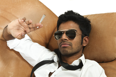 doped: man lying on the leather sofa