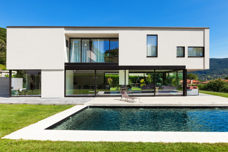 villa: Modern villa with pool, view from the garden Stock Photo