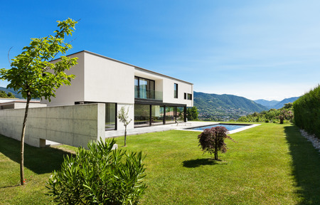 contemporary house: Modern villa with pool, view from the garden Stock Photo