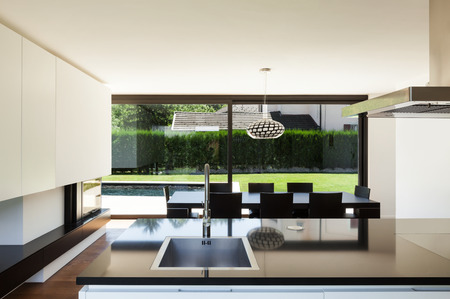 kitchen counter top: Modern villa, interior, view room from kitchen Stock Photo