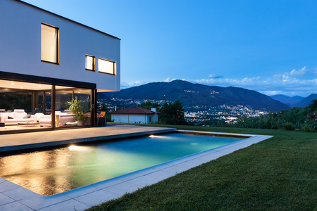pool water: Modern villa with pool, night scene