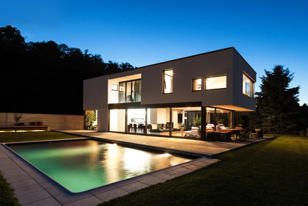 new homes: Modern villa, night scene,view from poolside