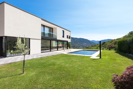 Modern villa with pool, view from the garden 스톡 콘텐츠