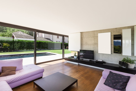 view of an elegant living room: Modern villa, interior, wide living room with pink divan Stock Photo