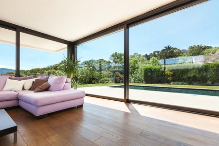 divan: Modern villa, interior, wide living room with pink divan Stock Photo