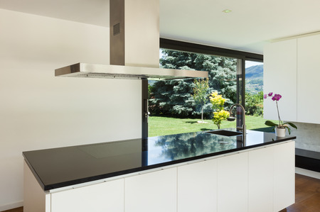 Modern villa, interior, beautiful white kitchen photo