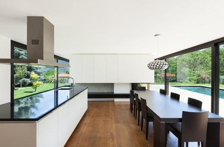 Modern villa, interior, beautiful dining room with kitchen island photo