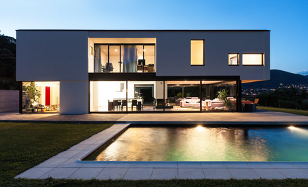 contemporary interior: Modern villa with pool, night scene