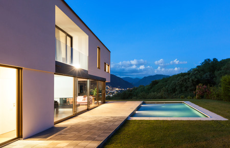 houses house: Modern villa with pool, night scene