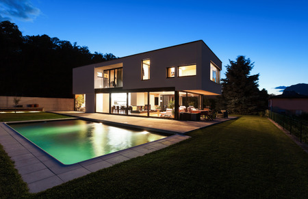 exterior architecture: Modern villa with pool, night scene