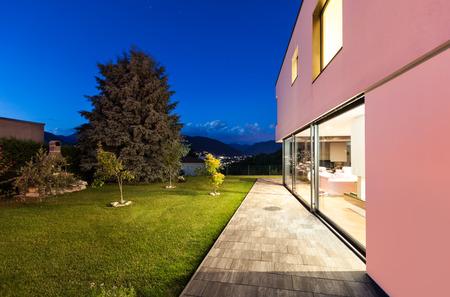 garden patio: Modern villa with garden, night scene Stock Photo