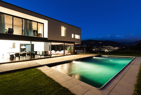 pool water: Modern villa, night scene,view from poolside