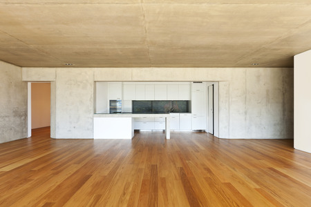 modern concrete house with hardwood floor,  kitchen Archivio Fotografico