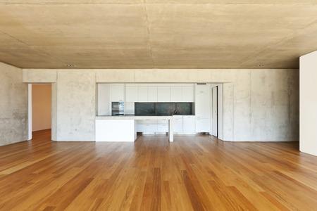piso piedra: moderna casa de concreto con piso de madera, cocina
