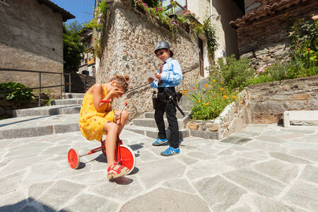 paradox: Scene with children playing, cop and driver Stock Photo