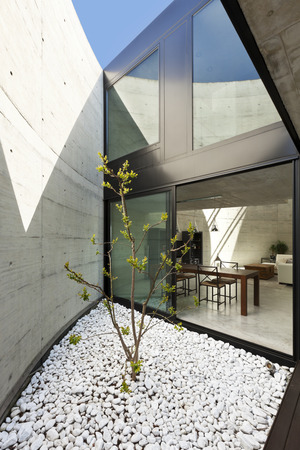 beautiful modern house in cement, dining room view from the veranda photo