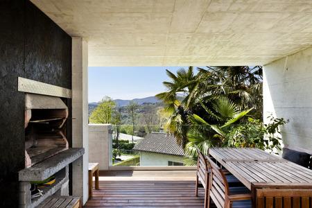 beautiful modern house, veranda with fireplace photo