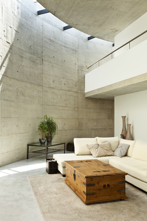 modern lifestyle: beautiful modern house in cement, interior, living room