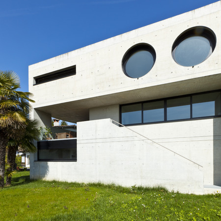 concrete construction: beautiful modern house in cement, outdoor, facade