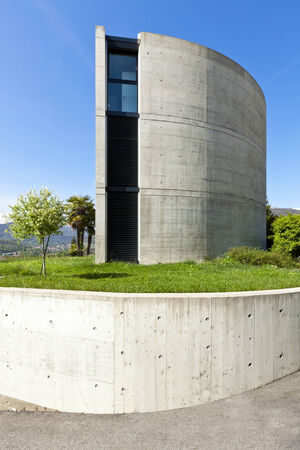 concrete construction: beautiful modern house in cement, outdoor, side view