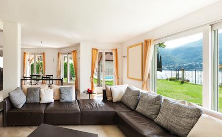 big window: interior house, nice living room with leather sofa
