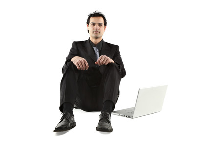 sitting down: business man over white background Stock Photo