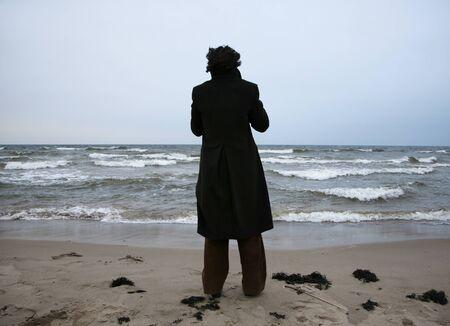 man fixing the horizon on the beach photo