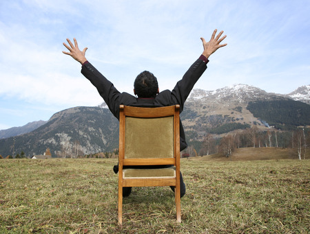 sitted: man alone sitted on a chair into the nature Stock Photo