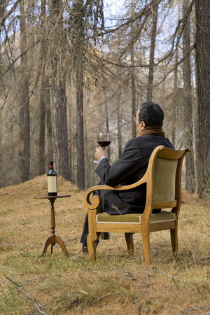 funny guys: elegant man drinks wine in high altitude