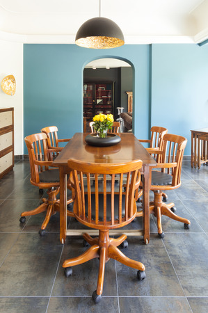 beautiful interior of a villa, wooden dining table view photo