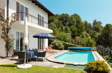 nice house: Nice terrace with swimming pool in a house Stock Photo