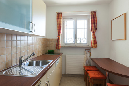 inside of: small domestic kitchen of a house, interior