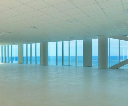 wide open: Interior, wide open space, skyscraper, windows overlooking the sea Stock Photo