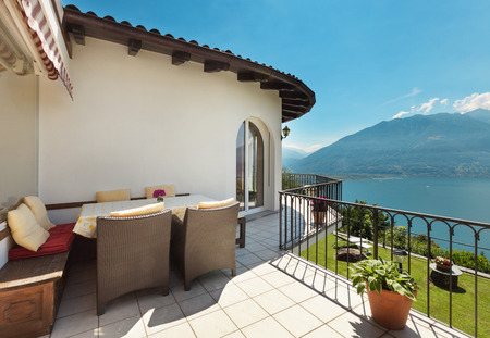 nice weather: Nice terrace of a villa on the lake Stock Photo