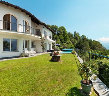 nice weather: Nice terrace with swimming pool in a house, garden