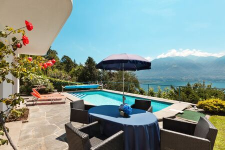 terrace house: Nice terrace with swimming pool in a house on the lake
