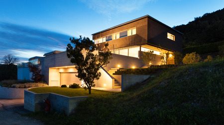 garage on house: Architecture modern design, beautiful house, night scene Stock Photo