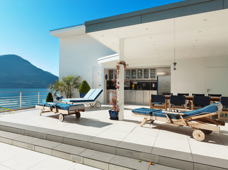 beautiful terrace of a penthouse overlooking the lake outside photo