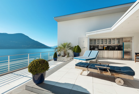balcony design: beautiful terrace of a penthouse overlooking the lake, outside