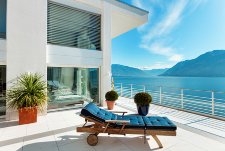 balcony window: beautiful terrace of a penthouse overlooking the lake outside